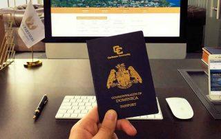 hand holding dominica passport